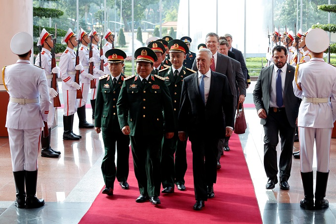 U.S. Secretary of Defense Jim Mattis and Vietnams Defence Minister Ngo Xuan Lich walk to the meeting room in Hanoi, Vietnam January 25, 2018. Photo by Reuters/Kham