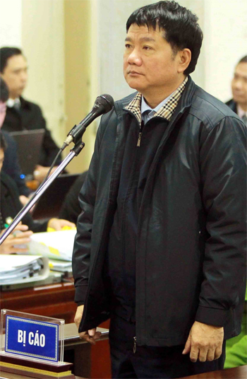 Dinh La Thang, former board chairman of PetroVietnam, stands at a corruption trial in Hanoi on Thursday. Photo by Vietnam News Agency