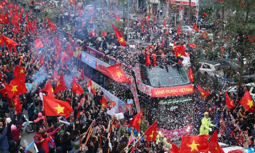 Crowds line 30km of streets to welcome Vietnam's U23 football heroes home