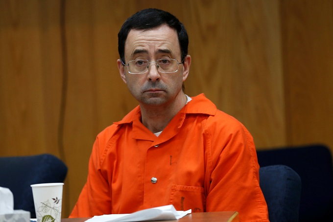 Larry Nassar, a former team USA Gymnastics doctor who pleaded guilty in November 2017 to sexual assault, listens to victims impact statements during his sentencing in the Eaton County Circuit Court in Charlotte, Michigan, U.S., January 31, 2018. Photo by Reuters/Rebecca Cook