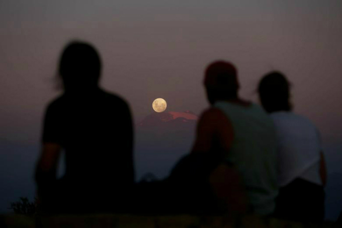 A full moon super moon rises over Los Andes mountain range in Santiago, Chile. REUTERS/Pablo Sanhueza