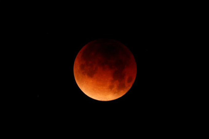 A lunar eclipse over Oceanside, California. Photo by Reuters/Mike Blake