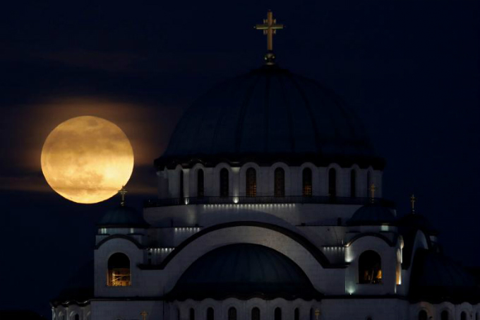 A full moon rises behind St. Sava temple in Belgrade, Serbia. REUTERS/Marko Djurica