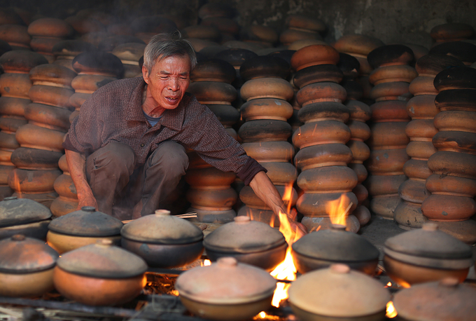 As Tet nears, production rises to hundreds of pots per day for some families. They have to take turns watching over the pots as the fish needs to be cooked for 14-15 hours straight.