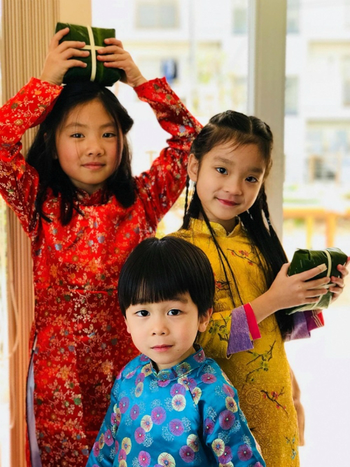 Vietnamese children wear ao dai in the kimono country for this special occasion.