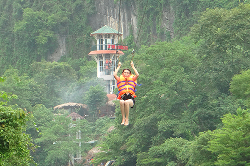 A touristpropels on a zip line in Quang Binh Province. Photo by Phong Nha Tourism Center