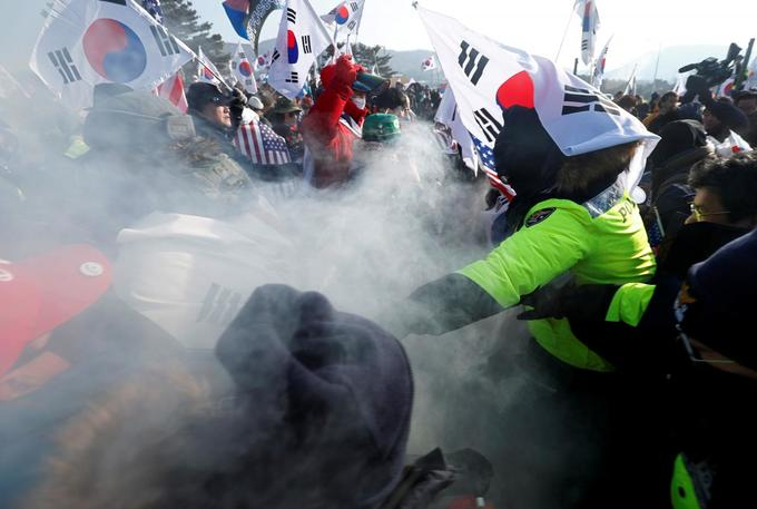 Anti-North Korea protesters burn flags before Olympic opening ceremony