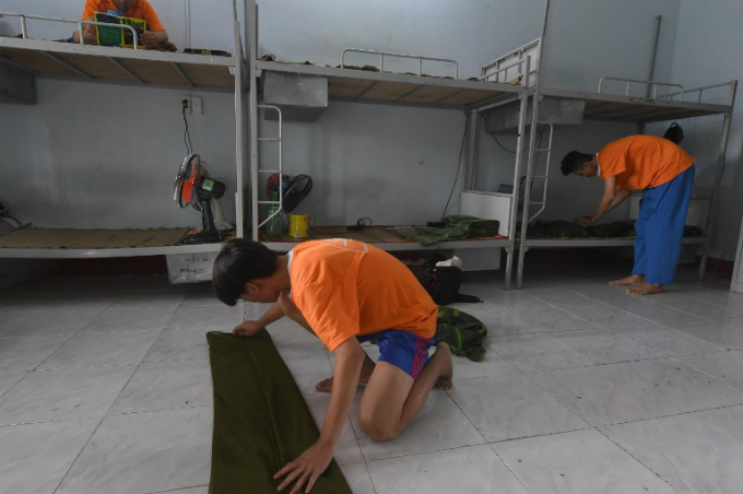 Students from the IVS arrange their dormitory room after lunch in the campus in Ho Chi Minh City.