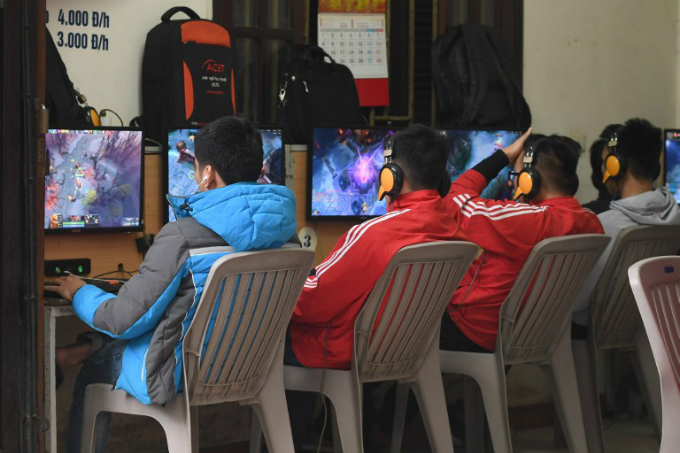 High school students play online games at a shop in Hanoi. Millions of youngsters are glued to gaming in Vietnam, where some 30 percent of the population of 93 million have smartphones, and about half have internet access. Photo taken on January 4, 2018 by AFP/Hoang Dinh Nam.