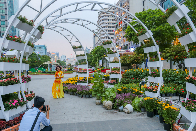 What I love about this years flower street is a unique style of each area, said Hanh, wearing the Vietnamese traditional long dress, ao dai, for a photo shoot.