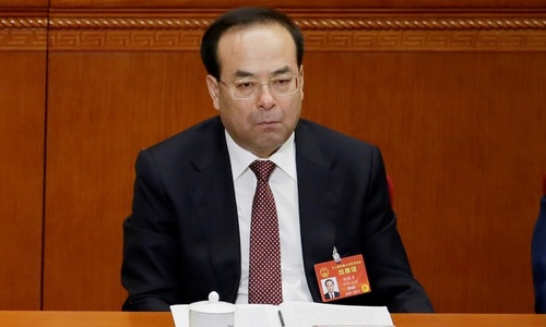 China charges former Politburo member with bribery