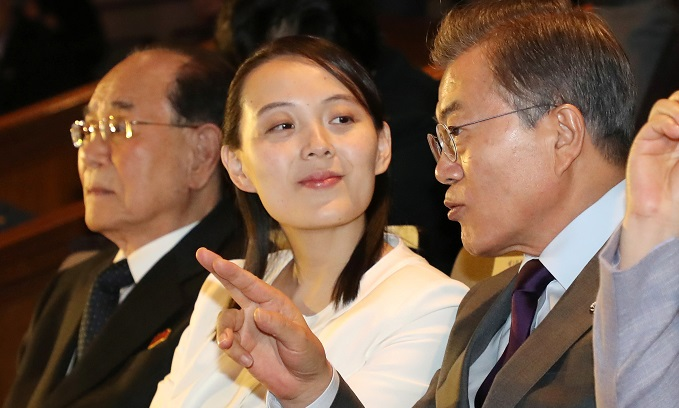 South Korean President Moon Jae-in talks with Kim Yo Jong, the sister of North Koreas leader Kim Jong Un, while watching North Koreas Samjiyon Orchestras performance in Seoul, South Korea, February 11, 2018. Photo by Yonhap via Reuters