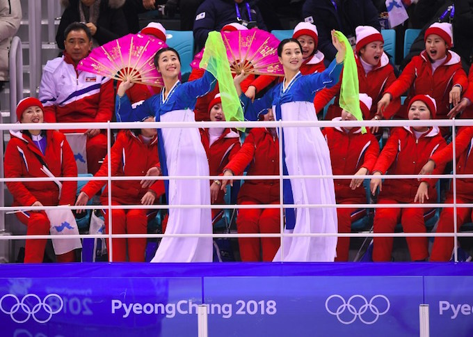 North Koreas cheerleaders cheer during the womens preliminary round ice hockey match between Switzerland and the Unified Korean team during the Pyeongchang 2018 Winter Olympic Games at the Kwandong Hockey Centre in Gangneung on February 10, 2018. Photo by AFP/Jung Yeon-je