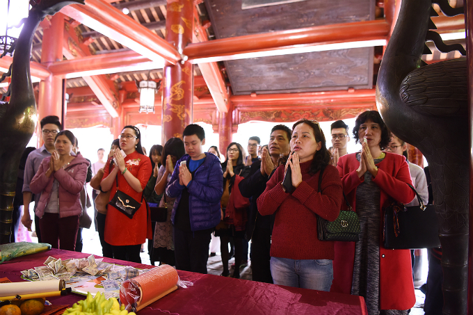 Many people also light incense at the shrine of former teacher Chu Van An, a high ranking mandarin of the Tran Dynasty in Vietnam, in the Temple of Literature.