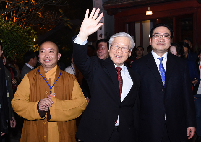 The Party leader waves at local people welcoming the New Year.
