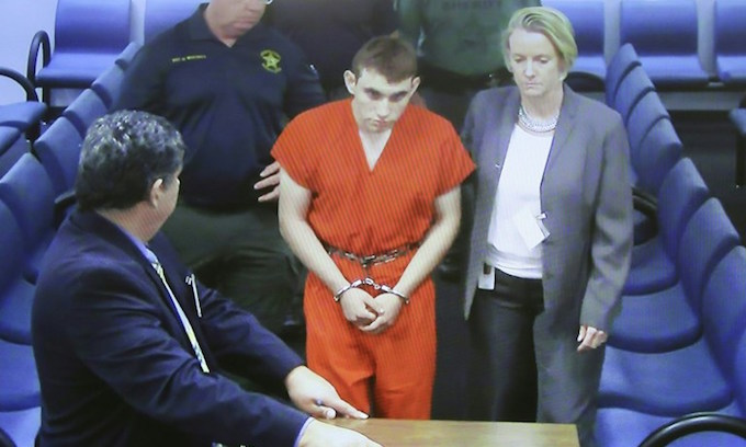 White supremacist-linked teen confesses to Florida shooting