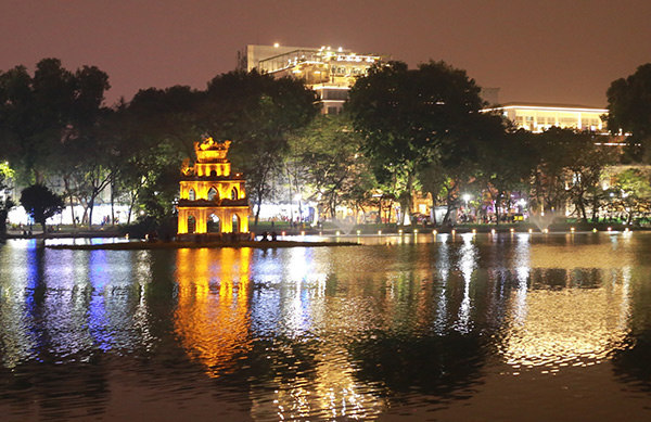 By 8 p.m., the Turtle Tower in the middle of Hoan Kiem Lake was already lit up as Hanoians started flockling to the streets.