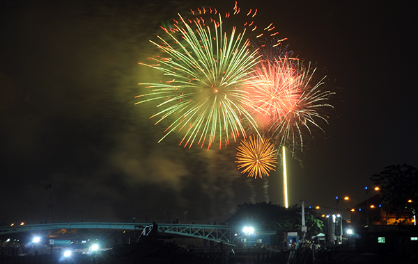 Fireworks lights up the sky over Saigon, marking the beginning of the new lunar year.