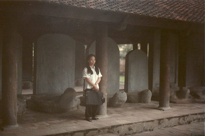 A student stood inside of the Temple of Literature, before its got crowded. The countrys first national university built in 1070 has become a holy place for students to come and pray for luck in school and exams.
