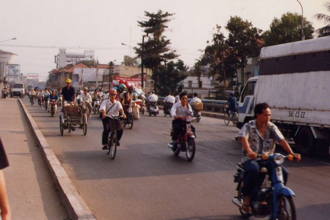 Another take of traffic in Saigon in 1997. Ten years later the government made it for all motorcycle drivers and passengers to wear a helmet on all roads.
