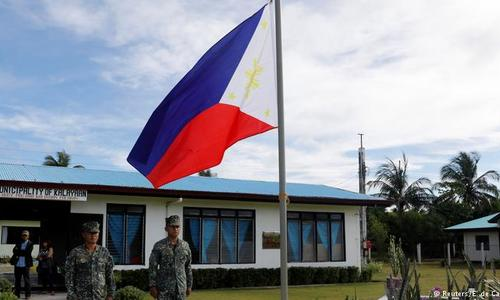 Philippines' Duterte plays down China military facilities in disputed sea