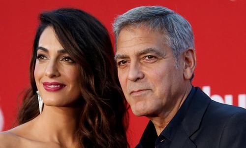 Clooney, Winfrey, Spielberg offer $500,000 each for gun control march