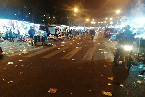 Near midnight, the markets ground was covered in garbage as visitors started leaving. Photo by Thien Long Pham.