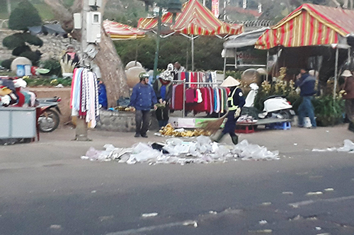Ly, who is living in Da Lat, said the towns always full of garbage every year after the first three days of the lunar year. Its overloaded and too much hardship for the street cleaning workers, Ly said. Photo by Tam Huynh.