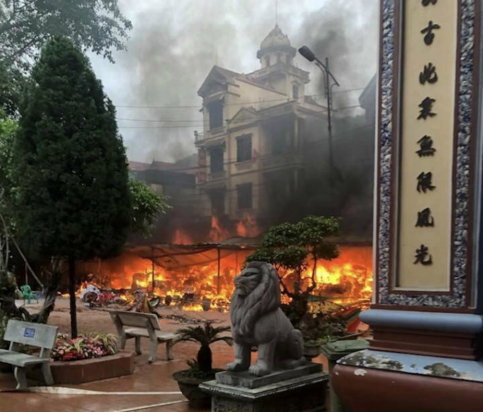 Fire from votive paper booths at a temple in Lang Son Province on February 20, 2018. Photo by The Thao & Van Hoa Newspaper