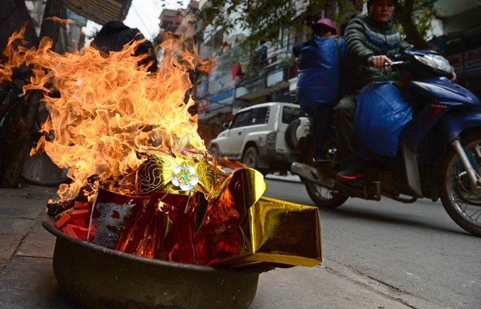 Vietnamese religious group pours water on paper burning ritual