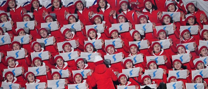 North Korean cheerleaders wave unification flags ahead of the opening ceremony of the Pyeongchang 2018 Winter Olympic Games at the Pyeongchang Stadium on February 9, 2018. Photo by AFP/Roberto Schmidt