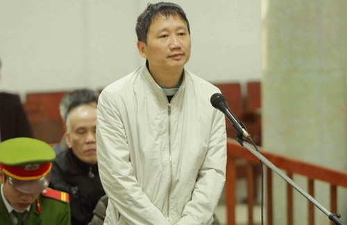 Trinh Xuan Thanh, a former PetroVietnam executive, listens during a verdict session at a court in Hanoi on Monday. Photo by Vietnam News Agency