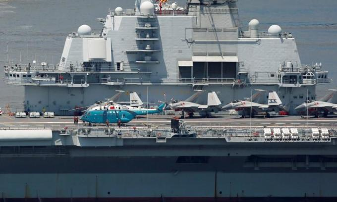 China ready to build larger aircraft carriers, paper says