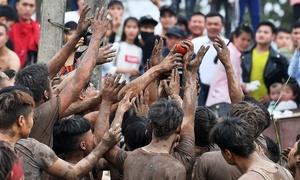 Men chase balls at bizarre northern Vietnamese festival