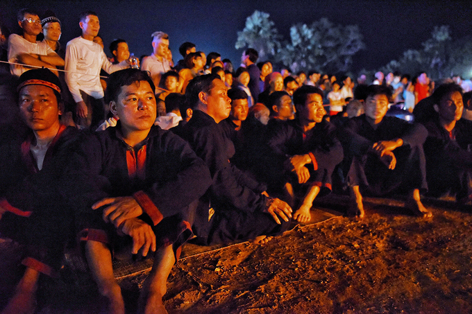 The fire dancers, selected from young Pa Then men, watch the ceremony as they eagerly wait for their turn to participate in the festival.