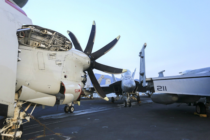 The aircraft wings are folded when parked on the deck so that the carrier can accommodate a large number of aircraft.