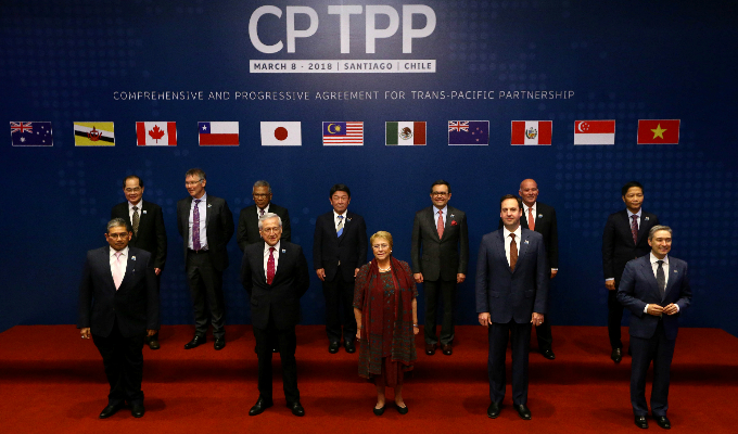 Members of Trans-Pacific Partnership trade deal pose for an official picture before the signing agreement ceremony in Santiago. Photo by Reuters
