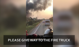 'We might be late': Video captures fire truck stuck in traffic in Vietnam