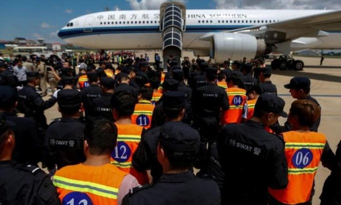 Cambodia arrests 100 suspects over China telecoms fraud
