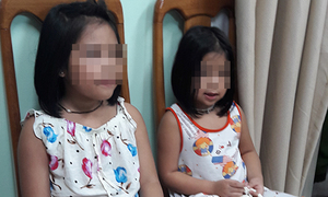 Woman held for kidnapping of American children in Saigon