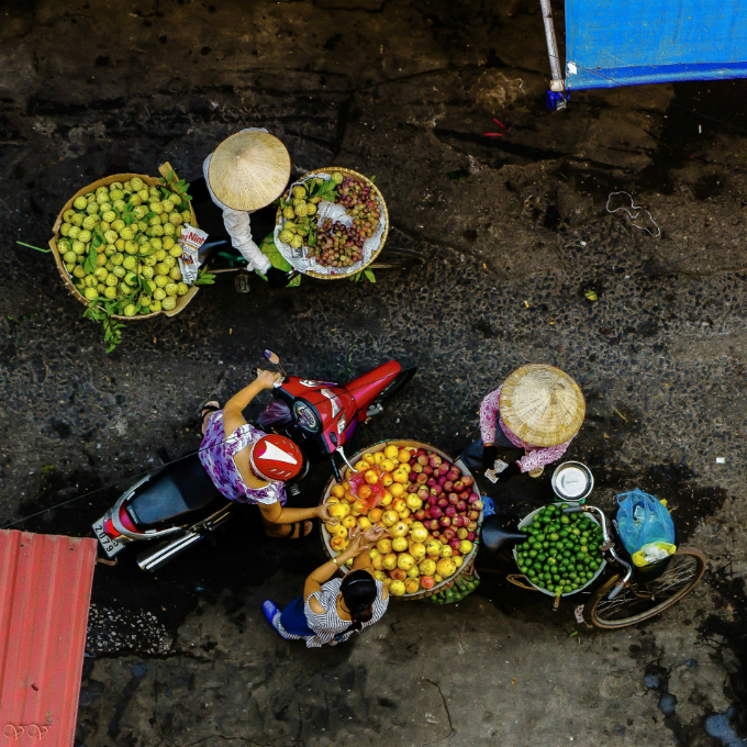 Street fruit vendors in Hanoi.