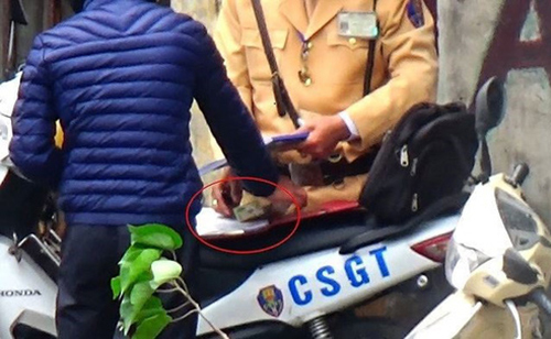 Hanoi suspends traffic cops after video points to streetside shakedowns