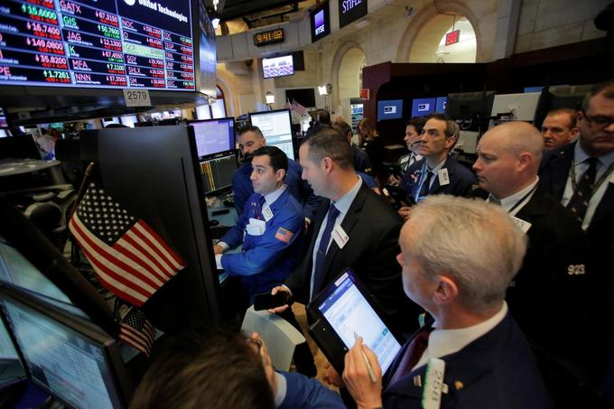 Wall St swoons on Tillerson firing, tech losses; oil dragged down
