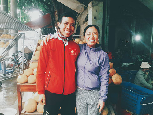Ha poses with one of the people who helped him along the way. Photo by Ho Nhat Ha