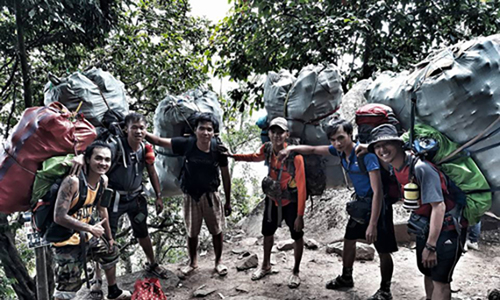 Volunteers scour mountain in effort to clear tourist trash in southern Vietnam