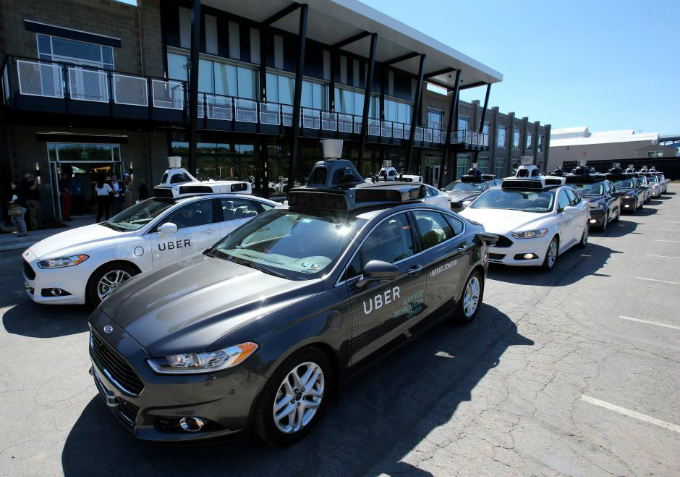 A fleet of Ubers Ford Fusion self driving cars are shown during a demonstration of self-driving automotive technology in Pittsburgh, Pennsylvania, U.S. on September 13, 2016. Photo by Reuters/Aaron Josefczyk/File Photo