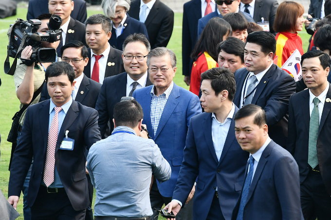 South Korean president Moon Jae-in, center, arrives at the football field of the Vietnam Football Federation (VFF) in Hanoi a few hours after he and his wife touched down in the capital city of Vietnam for a three-day visit at the invitation of his Vietnamese counterpart Tran Dai Quang. The president and first lady Kim Jung-sook are here to have a meeting with Vietnams U23 national football players and their South Korean coach Park Hang-seo.