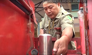 Self-made firefighting tricycle battles blazes in Saigon's alley matrix