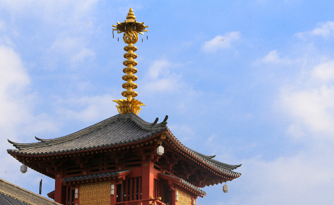 On top of the roof stand a pole that can be found at several pagodas and temples in Japan.