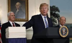 Trump signs budget deal after raising government shutdown threat